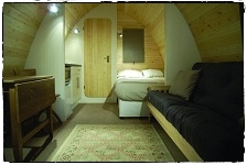 Fully fitted pod 'Ullmhór' with double bed, mini-kitchen, sofa-bed, table & chairs and a washroom with W.C.