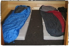 Basic Sleeping Bag & Mattress layout for two Adults in Standard Pod 'Beag'.